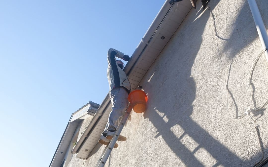 cleaning-eavestroughs-is-dangerous-gutter-guards-for-maintenance-free-home-exterior